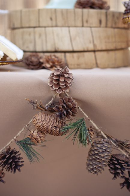 a pinecone and evergreen garland can be a nice DIY decoration