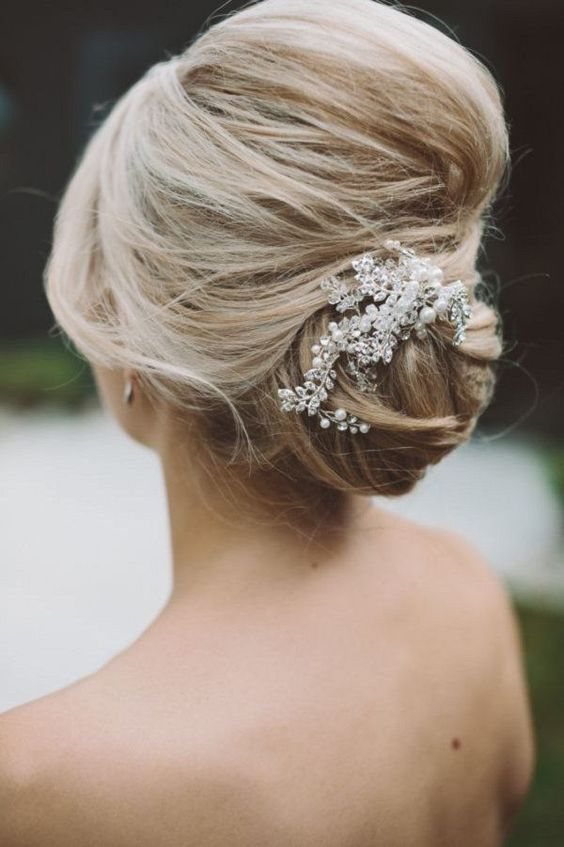 an elegant wedding updo hairstyle with pearl headpiece