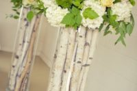 10 birch sticks in tall vases and fresh flowers on top for cool compositions