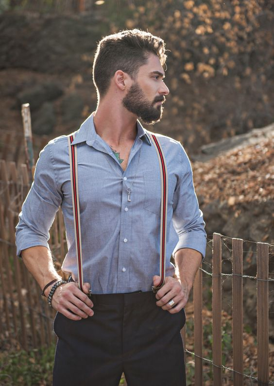black pants, a chambray shirt and striped suspenders