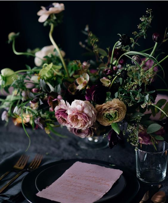 moody statement floral decoration and black plates