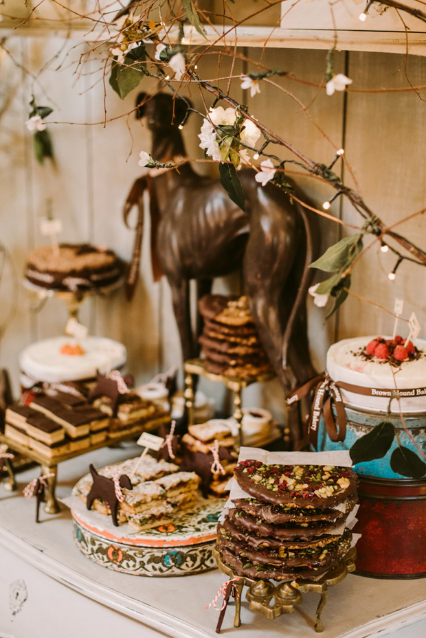The dessert table looks impressive and very yummy
