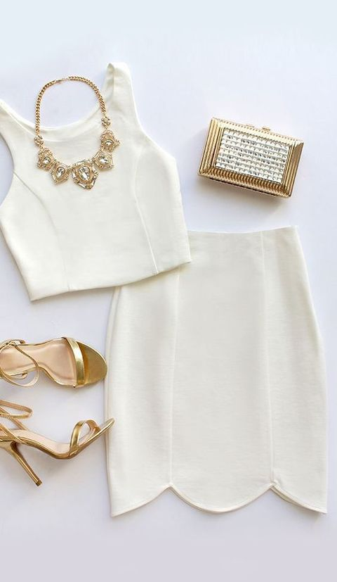 a plain ivory separate with a scalloped hem pencil skirt, gold jewelry and shoes