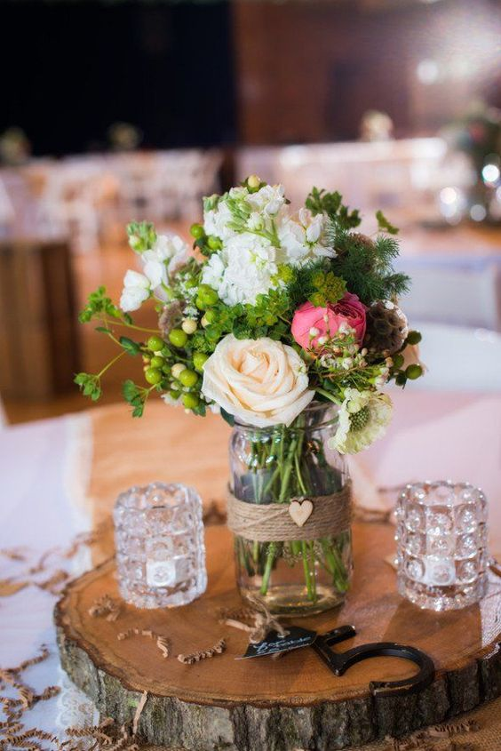 Picture Of A Wood Slice With A Floral Arrangement And