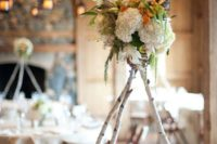 11 birch poles with a floral arrangement on top