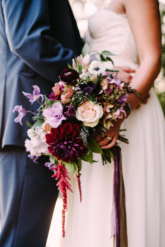 burgundy dahlias and ranunculus are ideal to make the bridal bouquet moody