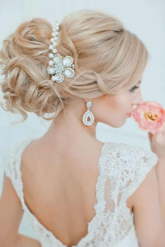 curly messy updo with a cool beaded headpiece  and matching earrings