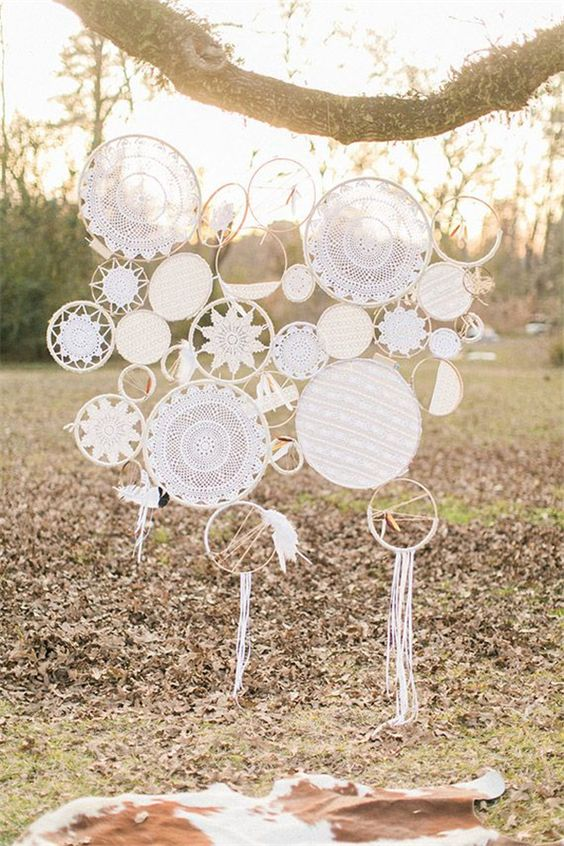 white boho dreamcatchers of embroidery hoops and doilies