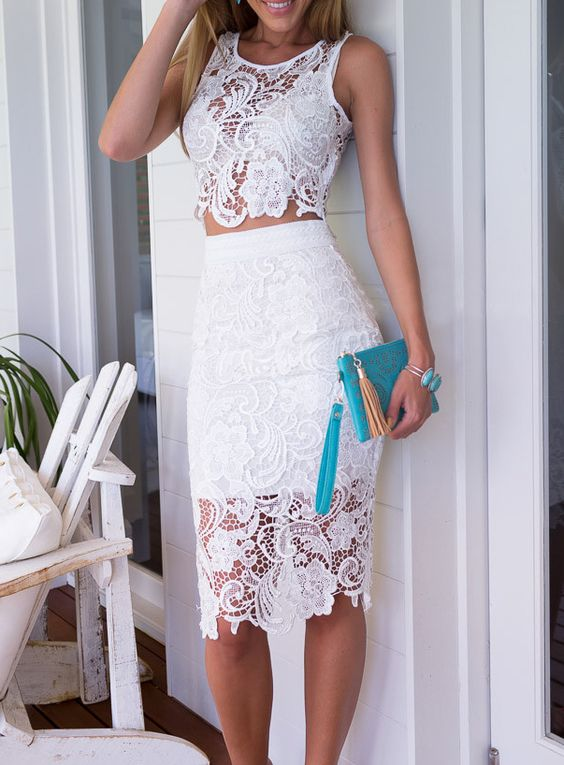 a white lace separate with a pencil skirt and a top and a cute clutch