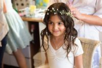 12 an ivory dress with short sleeves and a tulle skirt, a baby's breath crown
