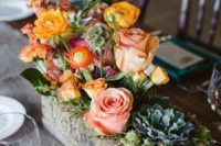 12 floral arrangement in a vintage cheese box