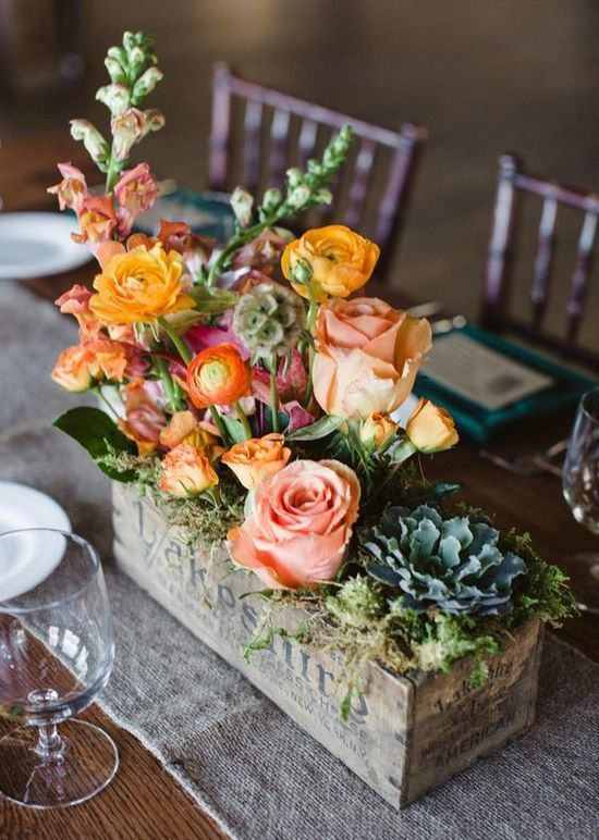 floral arrangement in a vintage cheese box