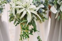 12 make a statement with thistles and pale air plants