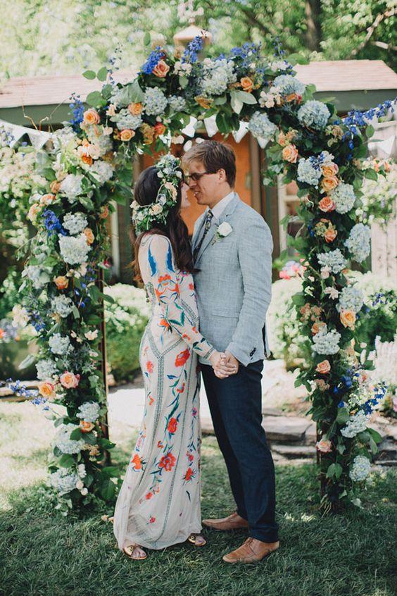 peachy, blue and pale blue wedding arch for a boho wedding