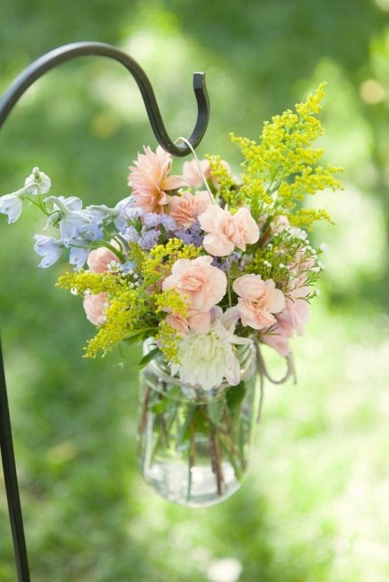 soft pastel floral arrangement for lining up the aisle
