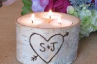 13 a birch bark log with candles for table decor