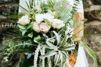 13 an eye-catchy tropical-inspired bouquet with blush roses, eucalyptus, air plants and greenery