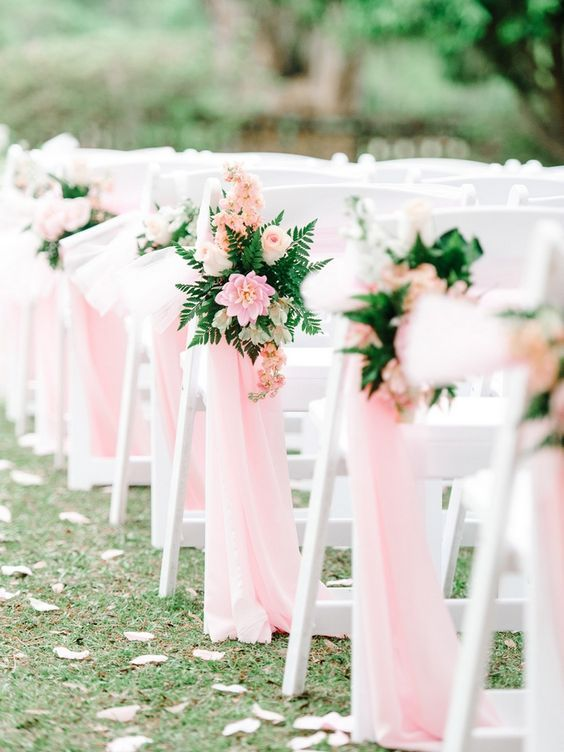 13 pink and blush flowers, fern and pink ribbons plus pink petals on the aisle