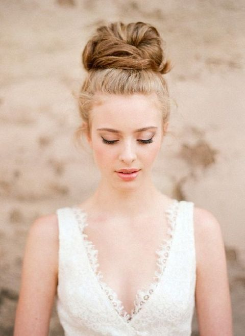 a cool twisted top knot with hair around