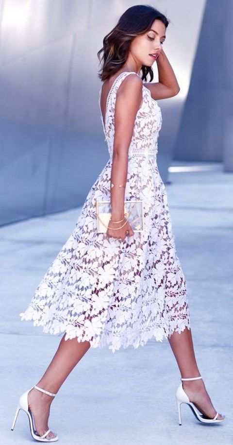a floral lace midi dress with a V cut on the back, a sheer clutch and white heels make this outfit looks WOW
