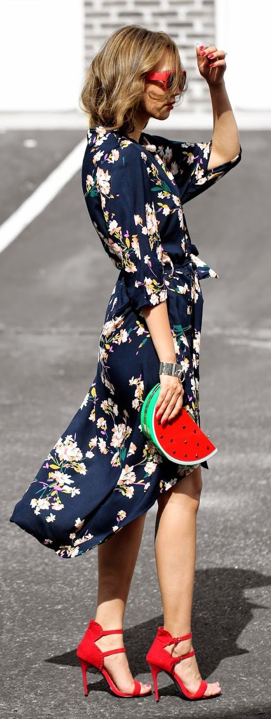 navy floral dress with a slit, a watermelon clutch and red heels