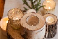 15 birch logs used for centerpieces and as candle holders