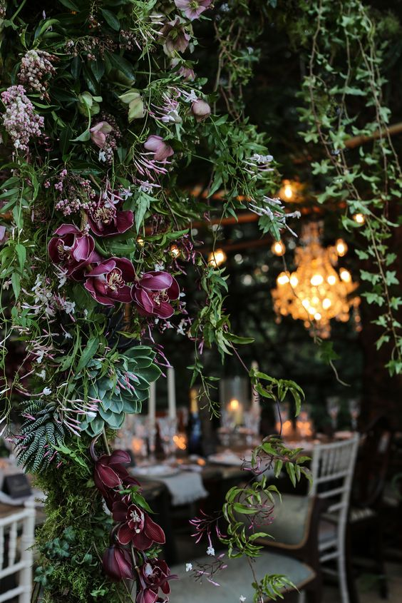 suspended greenery and burgundy flowers and succulents