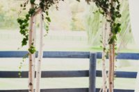 16 a birch branch arch topepd with greenery and blush roses is rustic classics