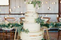 16 a semi naked wedding cake with greenery
