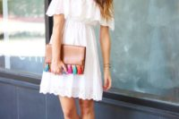 16 a white cold-shoulder dress with crochet lace, hot pink shoes and a clutch with tassels