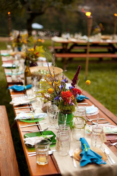 colorful table setting with wildflowers and bold dishes