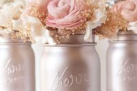 16 pearl-colored mason jars with blush and neutral blooms