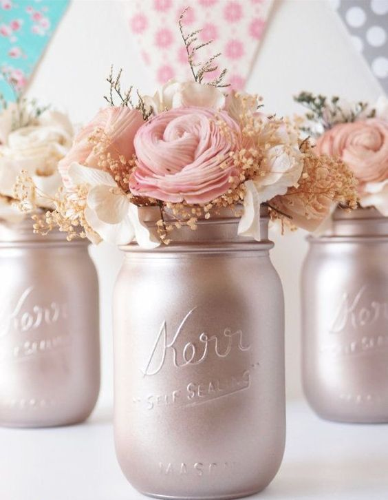 pearl-colored mason jars with blush and neutral blooms