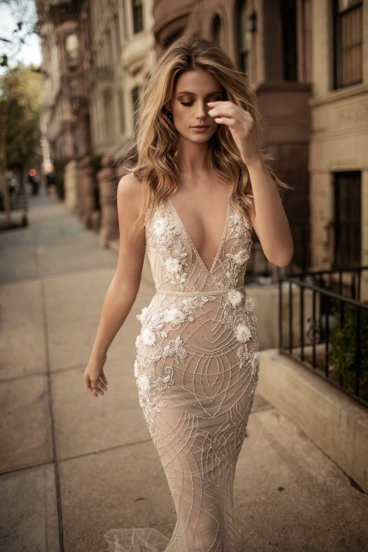 Plunging neckline wedding dress in nude color with white lace appliques and beads