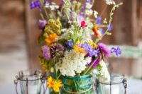 17 blue mason jars with wildflowers plus wire candle holders