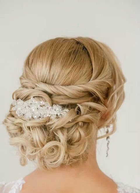 chic curly updo with a beaded hairpiece and curls around