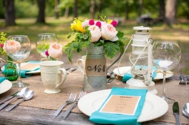 simple tin vases and burlap table runners are a proper idea for a camp wedding