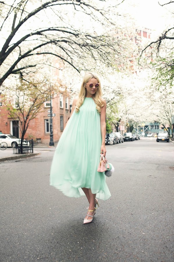 a mint midi dress with blush studded heels and a small bag