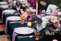18 a navy tablecloth and lavender-colored napkins make the table bolder