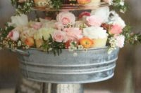 18 a rustic cupcake stand of a glavanized bath and bucket, filled with flowers