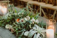 18 lush table decor with grass, air plants, peachy flowers, candles