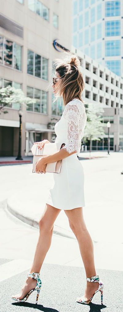 a white mini dress with a lace bodice and ankle strap floral heels