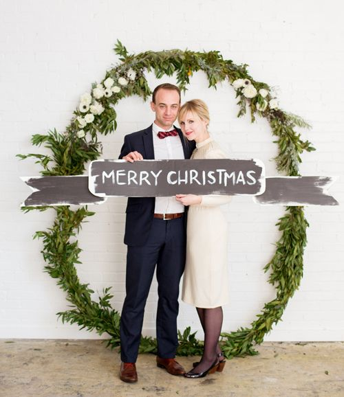 an oversized greenery and white blooms backdrop for taking pics