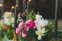 19 black candles, gilded candle holders and bold florals