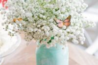 19 mint-colored mason jar with baby's breath and butterflies