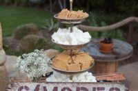 20 an s'mores bar on a wine barrel decorated with a simple sign