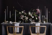 20 moody tablescape with black and white candles and moody textural florals
