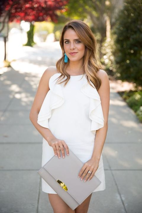 a white mini dress with ruffles, turquoise jewelry and a grey clutch