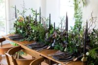21 greenery, black candles, glasses and dark platters for a moody wedding