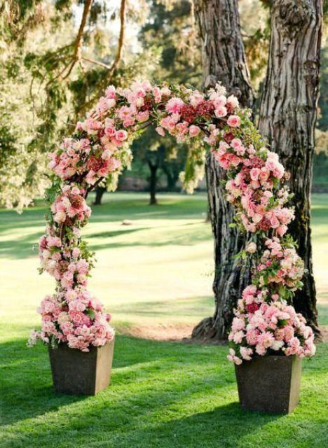 pink flower wedding arch is ideal for a garden ceremony